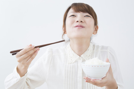Photo for Women to eat rice - Royalty Free Image
