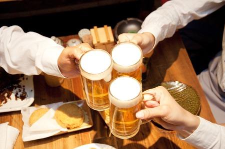 Photo pour Businessmen toasting with beer - image libre de droit
