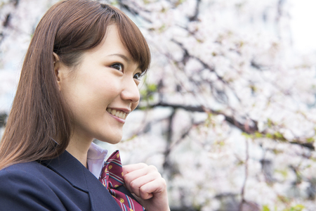 High school girl look at cherry blossoms