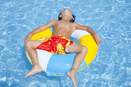 Photo for Boys of the float in the float pool swimsuit - Royalty Free Image