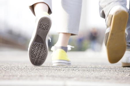 Photo for Feet of women wearing sneakers - Royalty Free Image