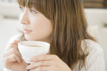 Photo for Woman drinking tea - Royalty Free Image