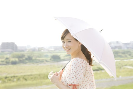 Photo for Women to walk the umbrella pierced - Royalty Free Image