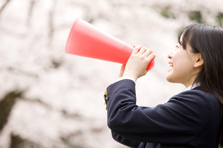 Middle school girls crying use the megaphone