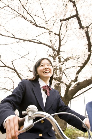 Junior high school girl riding a bicycle