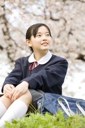 Junior high school girl sitting on the hill
