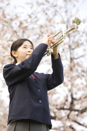 Female junior high school student trumpet