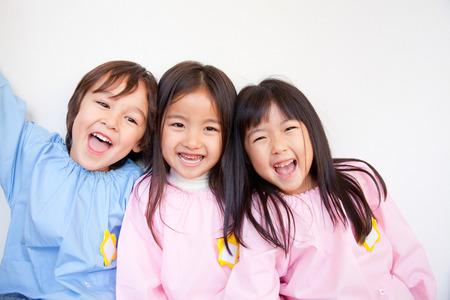 Foto de Kindergarten three smile - Imagen libre de derechos