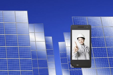 Work on the mobile screen wearing women clad with solar panels