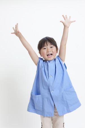 Foto de Girl of kindergarten children to the Banzai - Imagen libre de derechos
