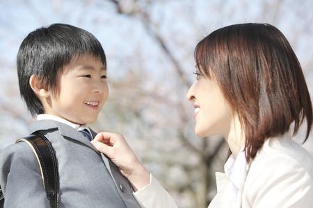 Mother prepare the children of tie