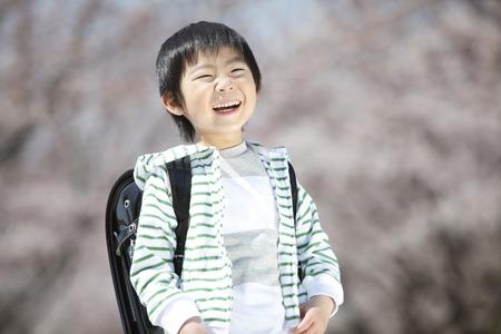 Elementary school boys laugh under the cherry tree
