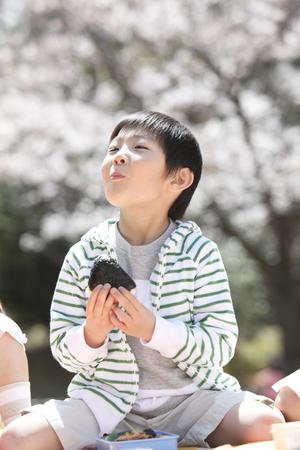 Boy eating rice balls