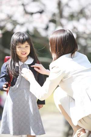 Mother prepare the elementary school girls' clothes