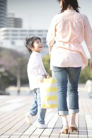 Photo for Boy with eco bag with his mother - Royalty Free Image