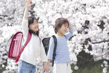 Elementary school students walking hand in hand