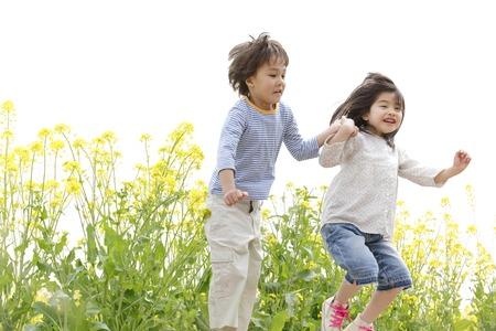 Children to jump hand in hand