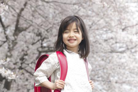 Smiling under the cherry blossom girl