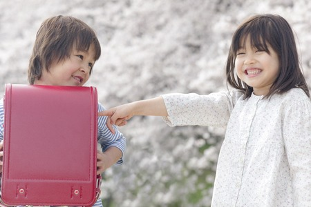 Children to smile under the cherry tree
