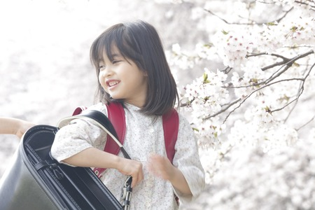 Girl smiling with a boy of school bags