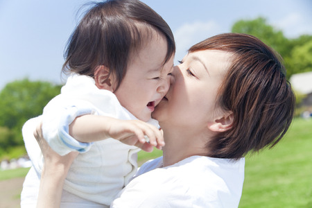 Photo for Mother to kiss and lift up the boy - Royalty Free Image