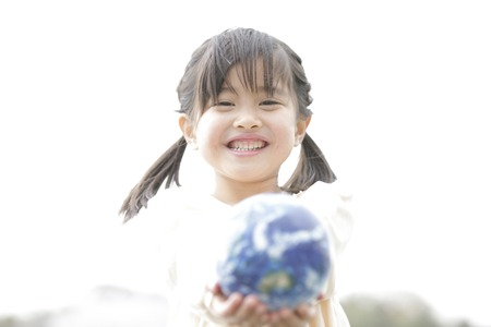 Girl smiling with a globe