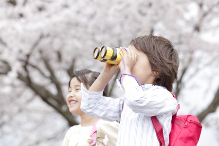 Girl smile and boy except for the binoculars