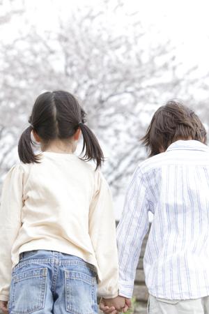 Children Rear View walking hand in hand