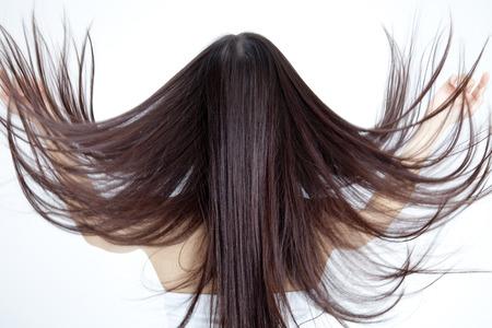 Photo pour From behind the hair long woman - image libre de droit