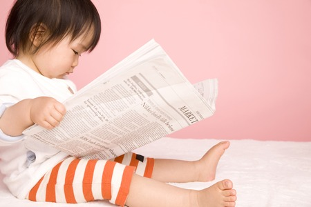 Photo for Baby read the newspaper - Royalty Free Image