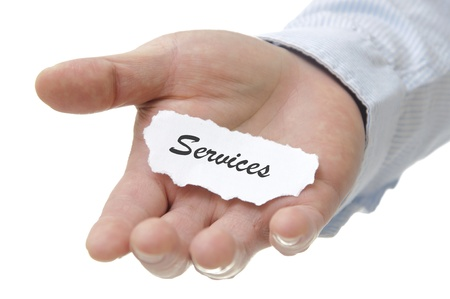 Photo pour Businessman holding services note with white copy space  - image libre de droit