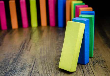 Photo for The domino effect of colorful wooden blocks, Selective focus - Royalty Free Image