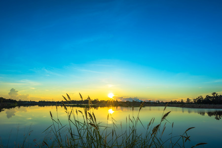 Photo pour Sunset landscape with blue sky at the calm lake - image libre de droit