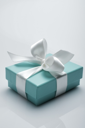 Photo for small turquoise box tied with a white ribbon - Royalty Free Image