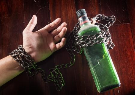 Foto de Alcohol slave, alcoholism - Imagen libre de derechos
