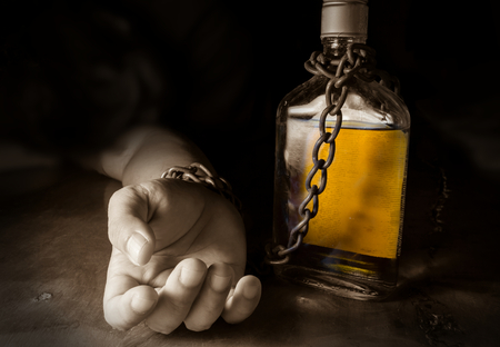 Foto de Alcohol slave or Alcoholism ,social problem. - Imagen libre de derechos