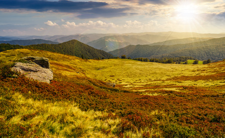 Photo pour huge boulders on the edge of hillside. fine weather in summer mountain landscape at sunset - image libre de droit