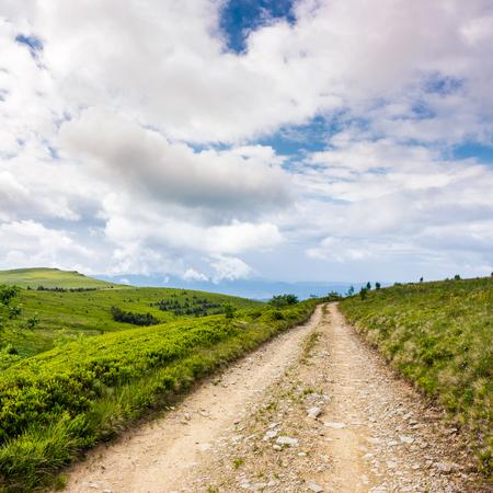 Photo pour road through mountain meadows. beautiful landscape of Polonina Runa ridge on a cloudy summer day - image libre de droit