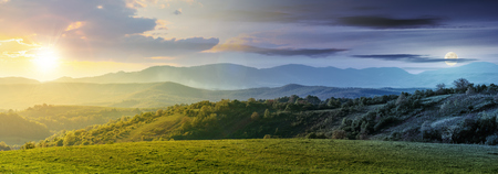 Photo pour day and night time change above panorama of romania countryside. wonderful springtime landscape in mountains with sun and moon. grassy field and rolling hills. rural scenery - image libre de droit