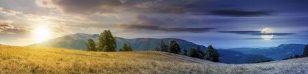 Photo for beautiful panoramic landscape in august. row of beech trees on the meadow in weathered grass. mountain range in the distance with sun and moon on the sky. day and night time change concept - Royalty Free Image