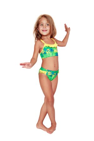 Pretty tanned little girl in swimsuit dancing on white background