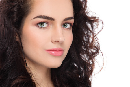Foto de Close-up portrait of young beautiful woman with fresh clean make-up and curly hair over white background - Imagen libre de derechos