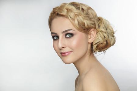 Foto de Portrait of young beautiful blonde woman with stylish prom hairdo - Imagen libre de derechos