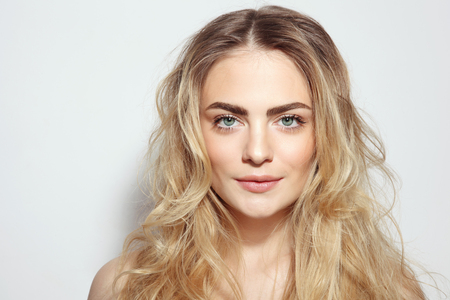 Foto de Portrait of young beautiful girl with long messy hair and clean make-up - Imagen libre de derechos