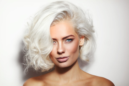 Photo for Portrait of young beautiful tanned platinum blonde woman with clean make-up - Royalty Free Image