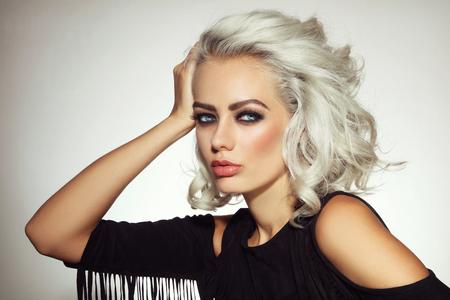 Foto de Vintage style portrait of young beautiful platinum blond woman with smoky eyes make-up - Imagen libre de derechos