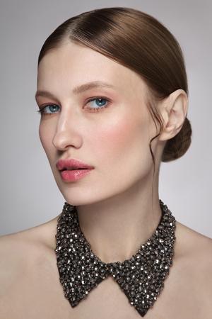 Foto de Portrait of young beautiful woman with fresh make-up and fancy necklace - Imagen libre de derechos