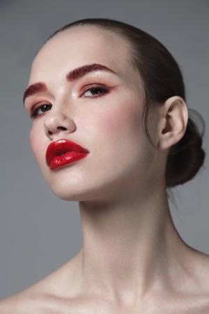 Foto de Portrait of young beautiful glamorous woman with red lipstick, selective focus - Imagen libre de derechos
