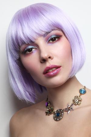Foto de Young beautiful sexy girl with violet hair and fancy make-up - Imagen libre de derechos