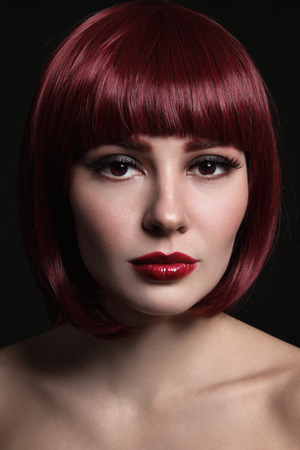 Foto de Portrait of young beautiful red-haired girl with bob haircut and stylish make-up - Imagen libre de derechos